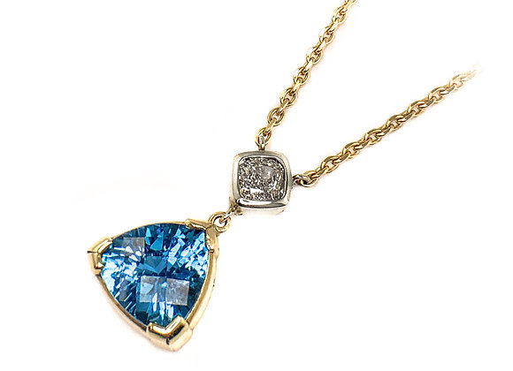 14k blue topaz and 0.30ct diamond pendant