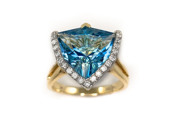 14k 5ct blue topaz and 0.26ct diamond ring