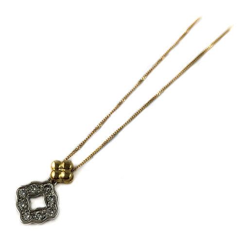 10k 0.25ctw diamond pendant
