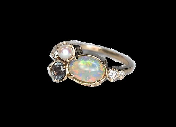 Custom designed opal and blue topaz ring