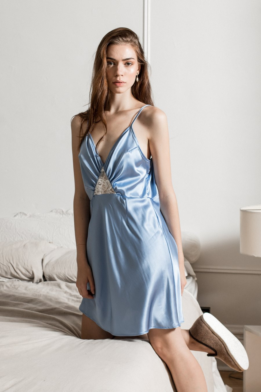 woman wearing blue nightgown slip from atelier aleur, sustainable ethical fashion brand