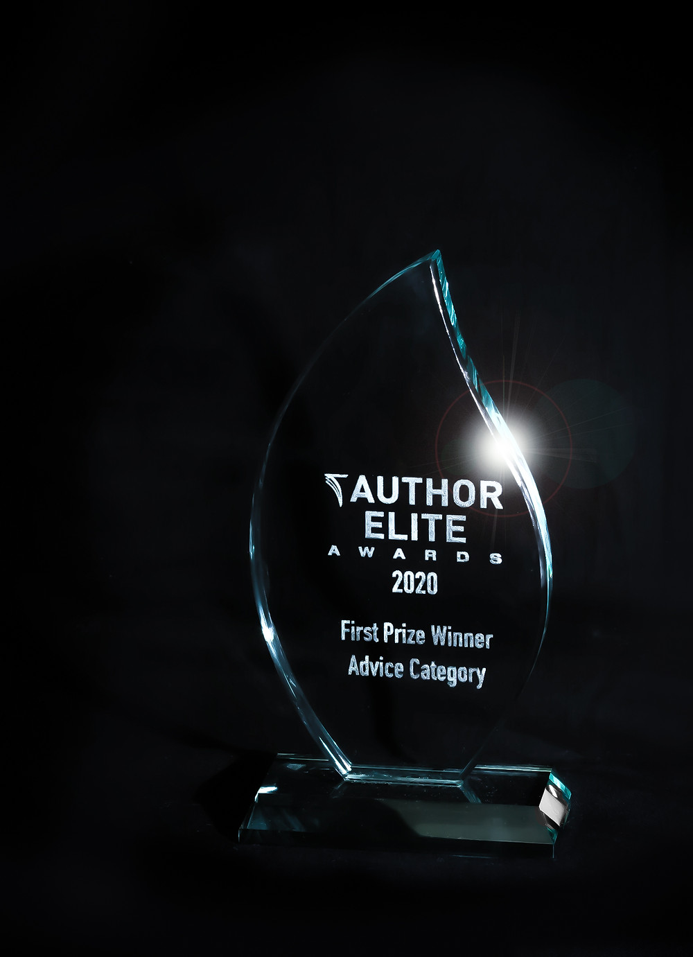 The Author Elite Award is a heavy glass engraved award in the shape of a candle flame. The engraving reads Author Elite Award 2020  Prize winner advice category.