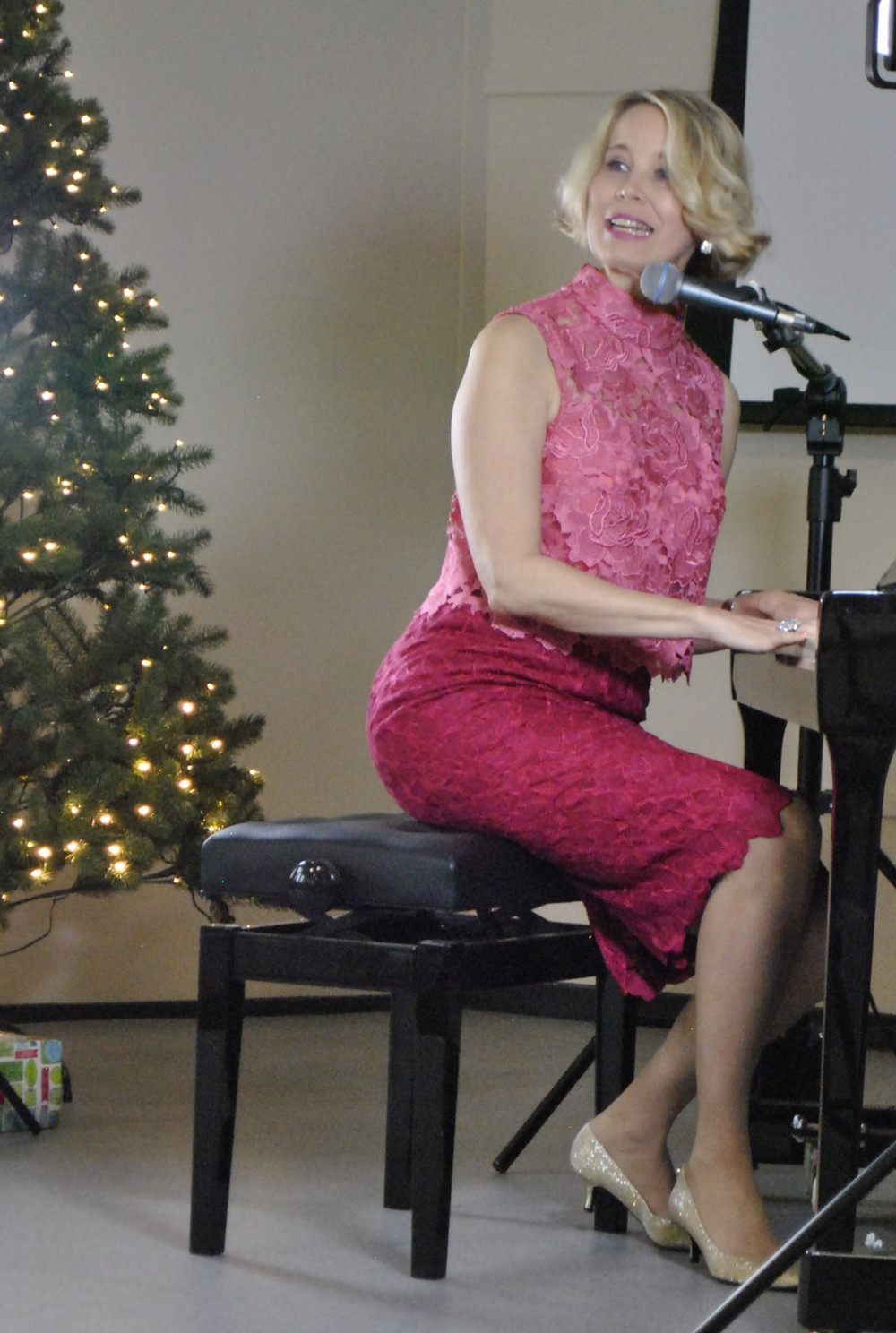 Karen Jacobsen singing I Believe You at Broken to Brilliant's Christmas in July hightea and launch of the audiobook Terror to Triumph