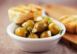 Garlic stuffed olives with crostini
