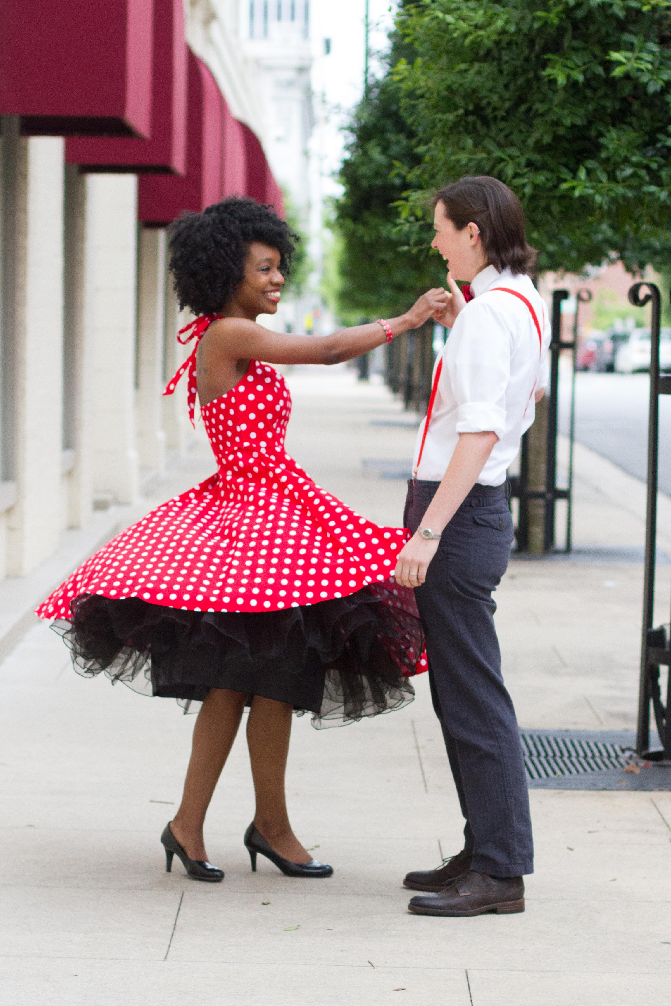 lesbian couple LGBTQ girl spinning dancing girlfriend