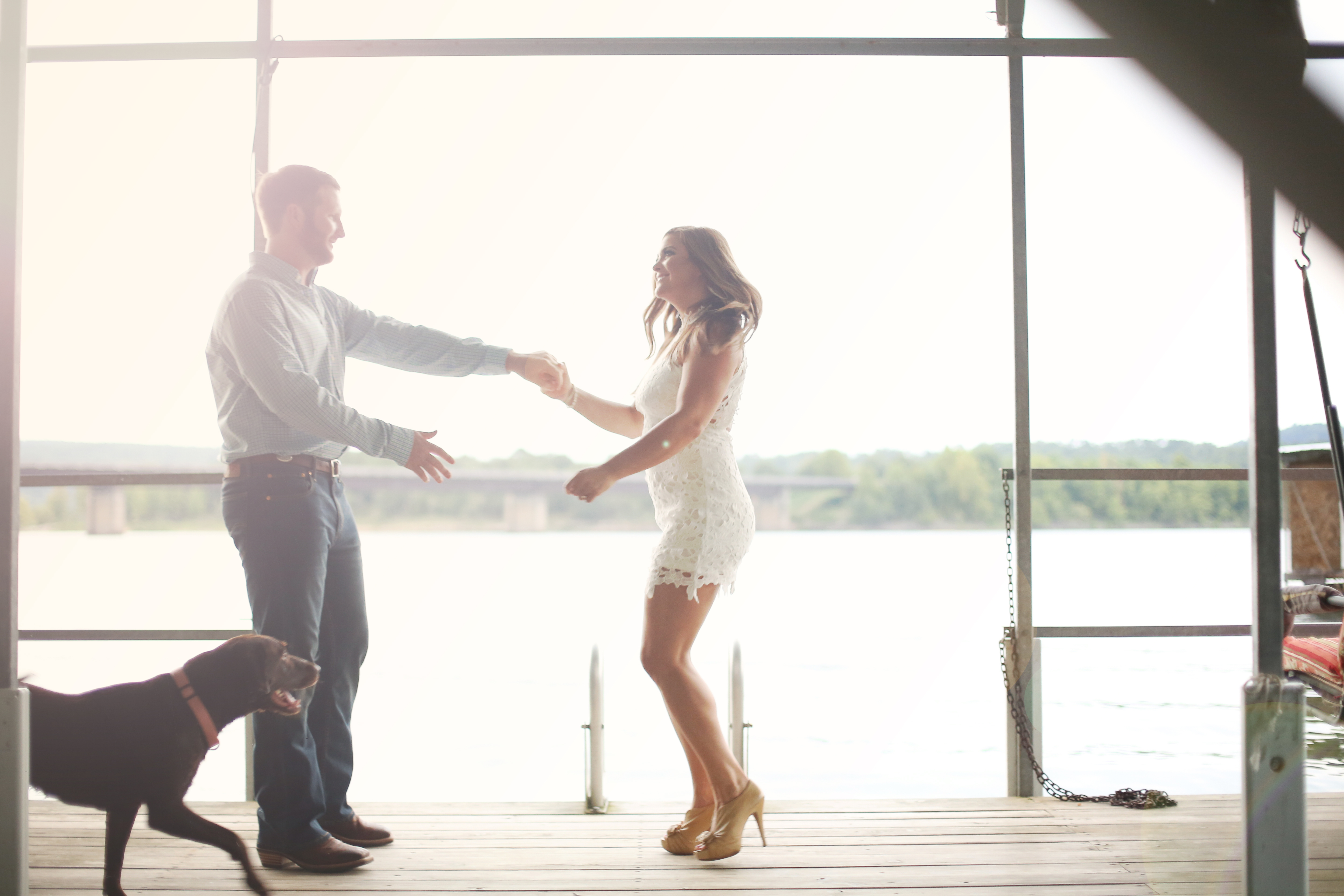 Engagement photo spinning and dancing on the dock dogs engagement shoot