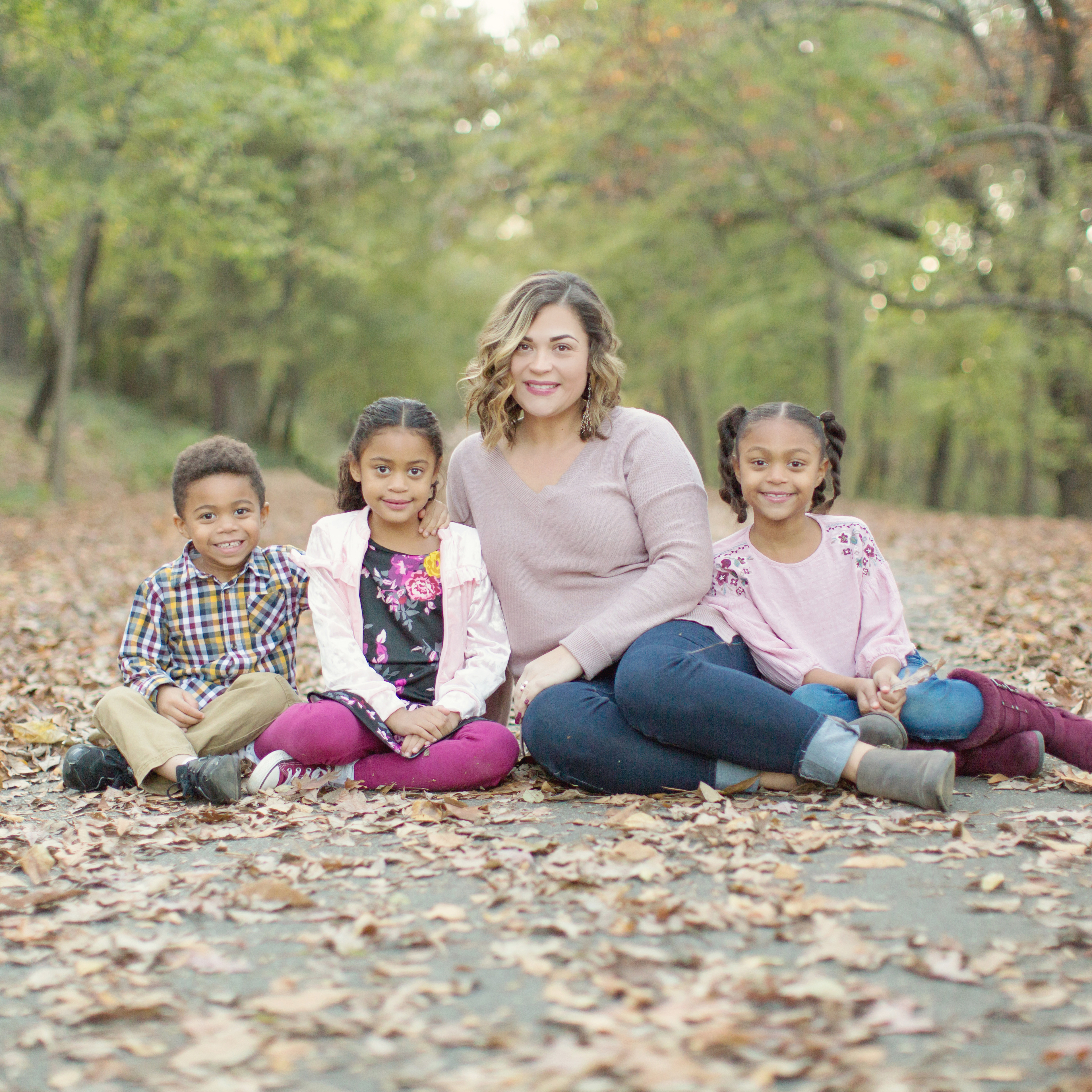 Family Portrait Photographer Single mom with three kids color coordinated in purple