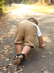 Little boy trying to get up stand up stumble fall