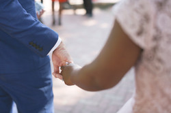 Wedding photos with black hand holding white hand