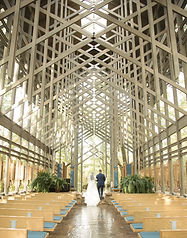 bride and groom at the altar in thorncrown chapel hot springs photographer wedding photographer