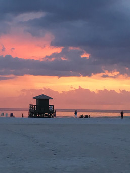 Life guard stand at sunset