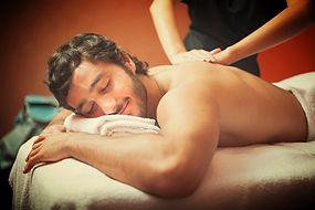 Enjoying a massage at The Tree Relaxation Retreat
