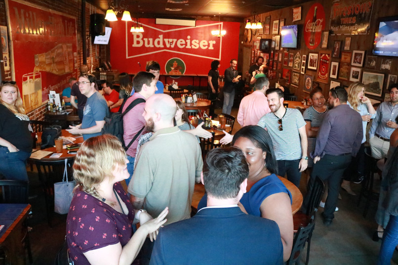 Young Democrats networking at Manuel's Tavern