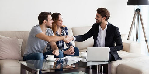 real-estate-agent-with-couple-on-the-cou