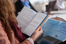 Woman Reading LGBTQIA+ Book with Rainbow Spine