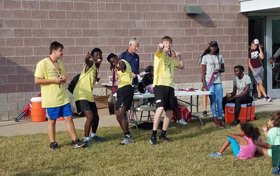 High School Boys' 4X100-Meter Relay winners pose, victorious