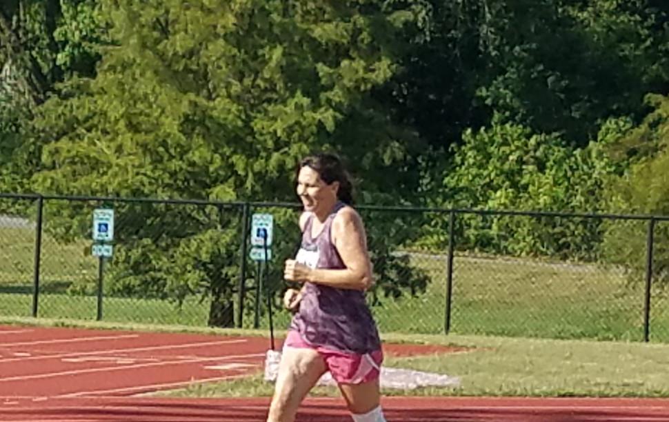 Open Women's Mile runner holds her stride