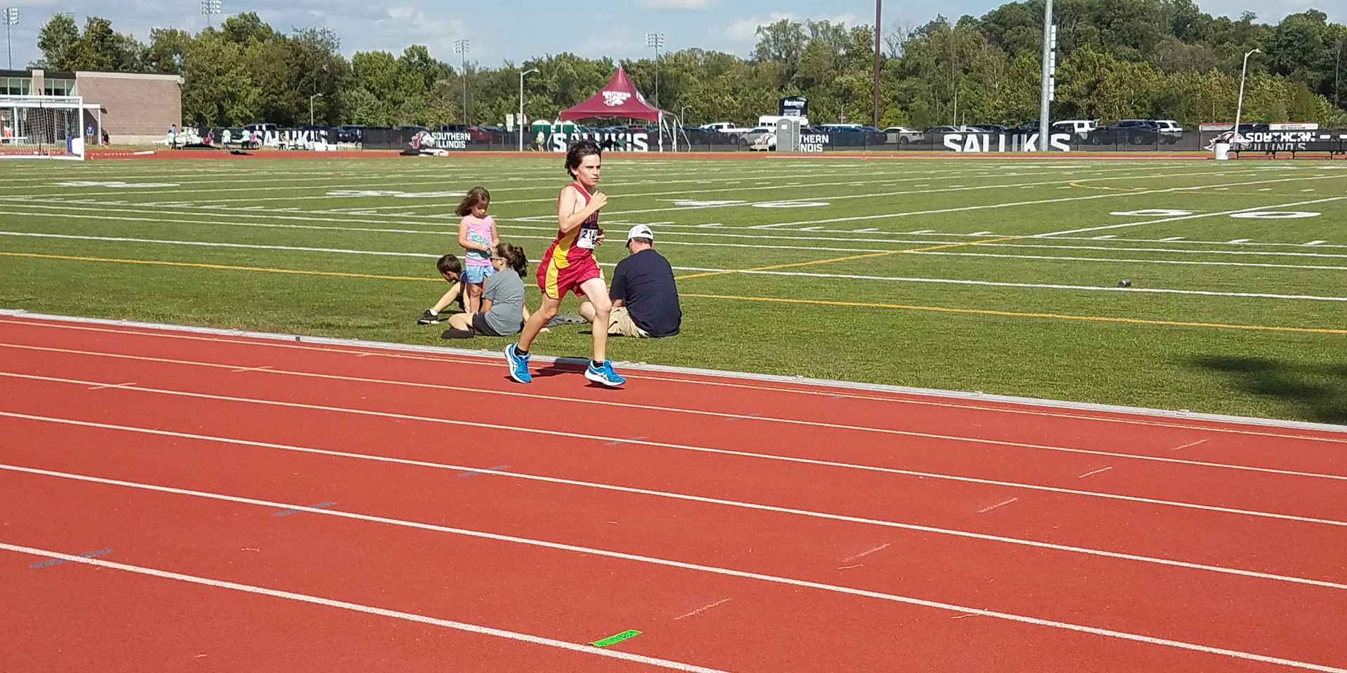 A Unity Point School Middle School Boys' Mile runner