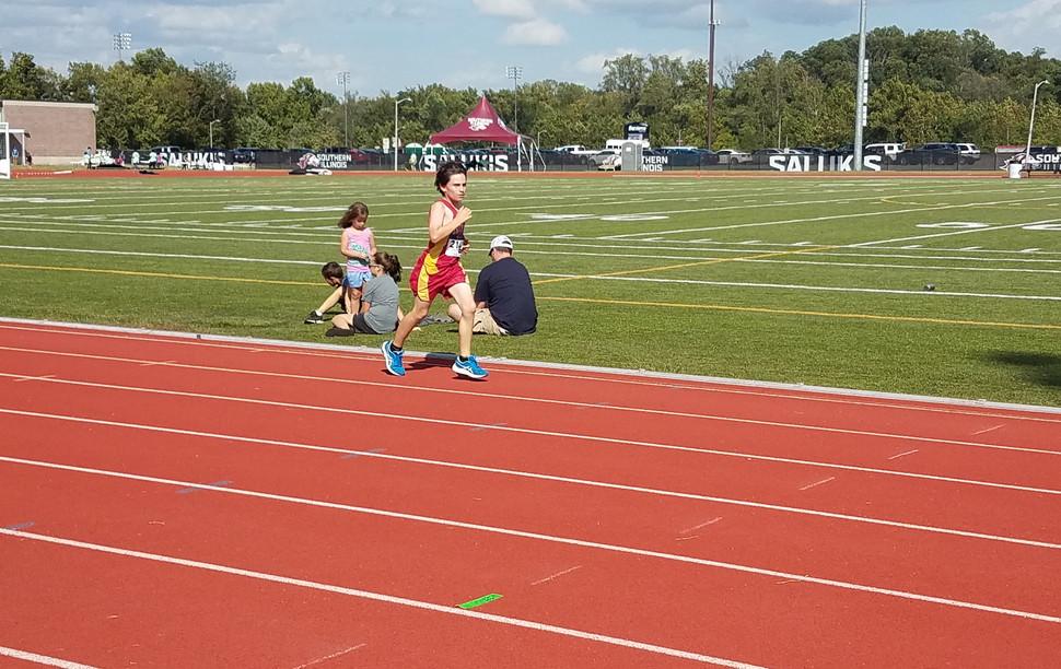 A Unity Point School Middle School Boys' Mile runner