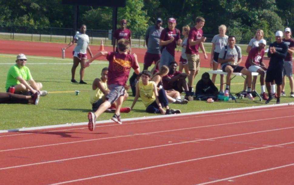 Unity Point Middle School Boys' Mile winner sprints home
