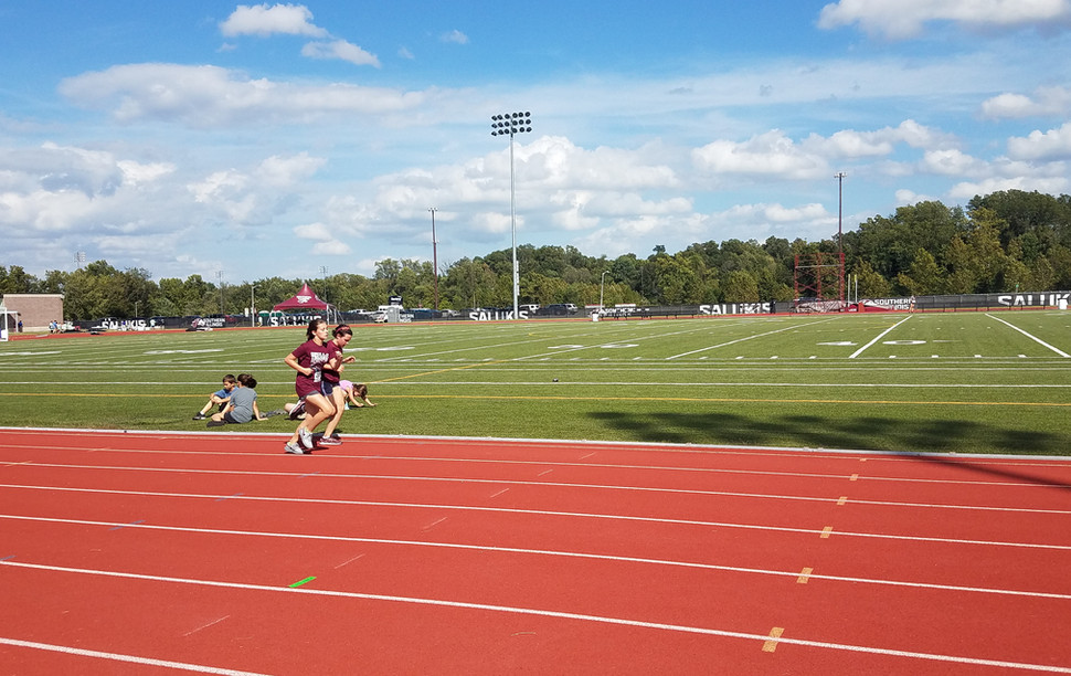 Unity Point School Girls' Mile runners pace one another