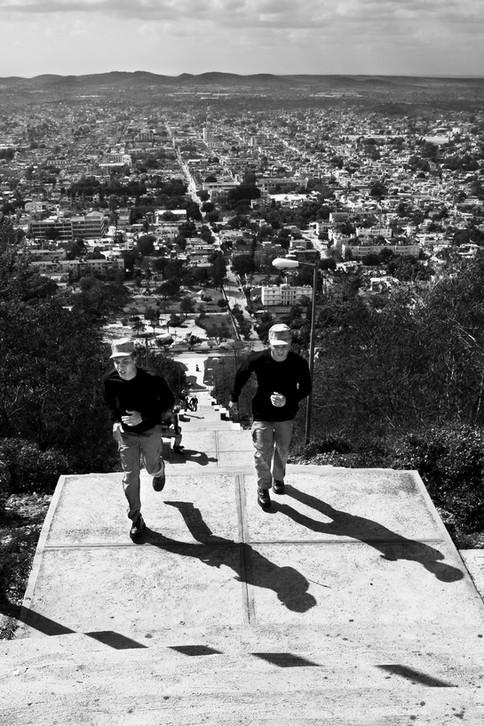 Military men climbing Loma de la cruz, Holguin, Cuba, 2015