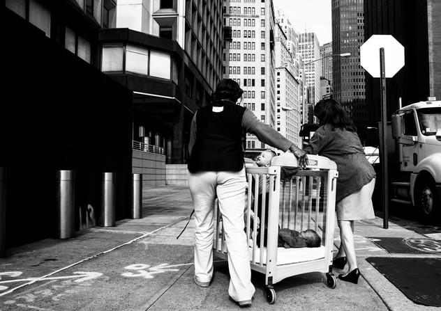 Babies moving on wall street, New york, USA, 2013