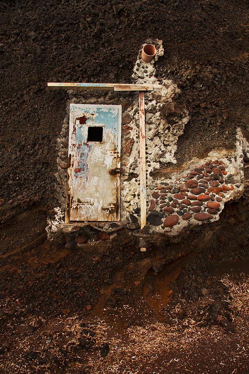 Door hanging in the cliff