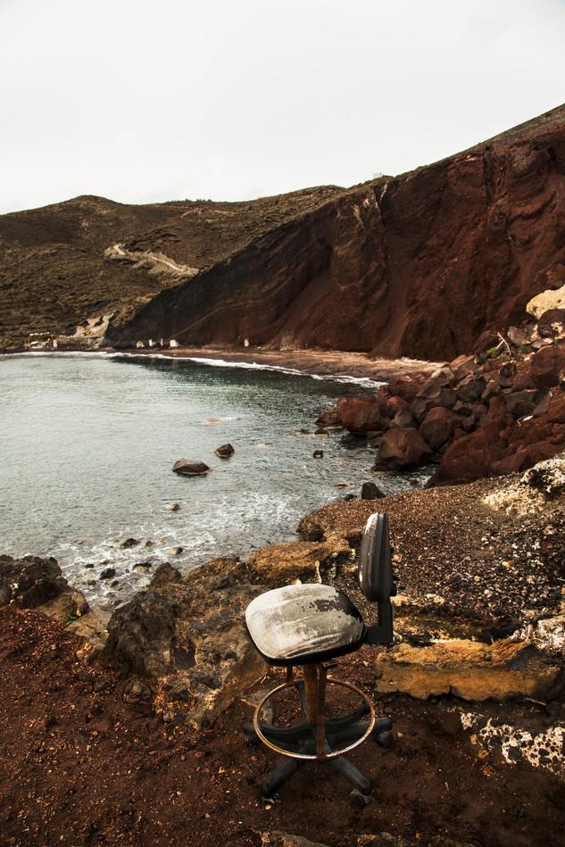 Broken chair near the cliff, Red Beach, Santorini, Greece, 2017