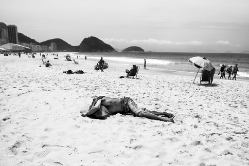 A man on the beach, Copacabana, Brazil, 2014