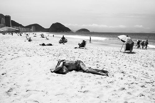 Man sleeping on Copacabana beach