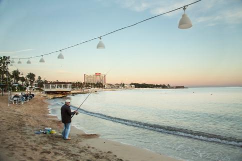 Fisherman at dusk, Antalya, Turkey, 2017