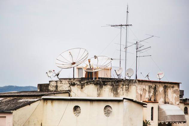 A man on the roof, Rio de Janeiro, Brazil, 2014