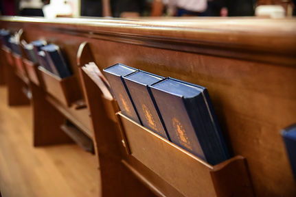 Bibles in the back of a pew