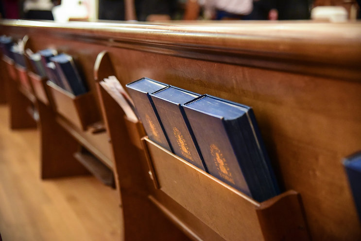 Bibles in back of a pew