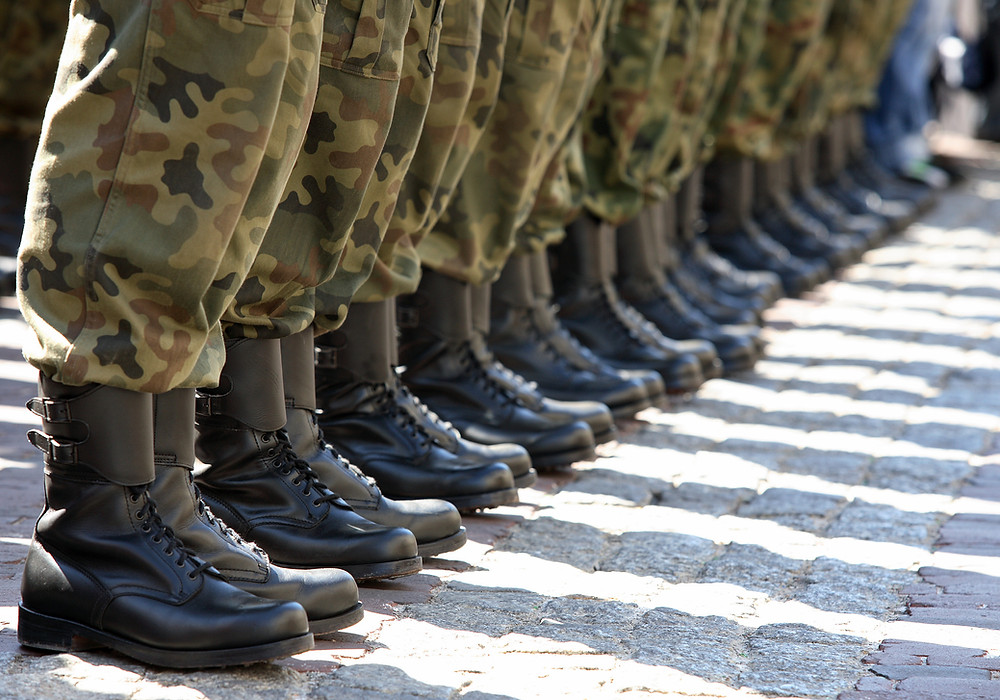 people lined up wearing army boots and uniforms