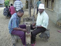 SM employees Jackson Nzaro and Charles Aribicho playing kigogo, Ngomeni
