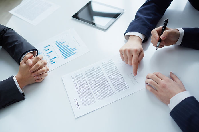 top-view-businessman-signing-documents (1).jpg