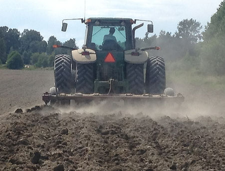 Mulching and discing in the soil for field preparation.