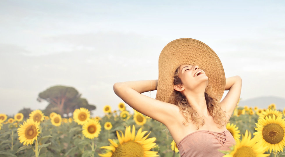 woman-standing-on-sunflower-field-3764579_edited_edited.jpg