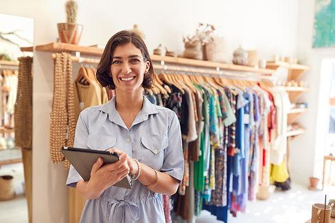 portrait-of-female-owner-of-fashion-store-checking-C276NBM.jpg