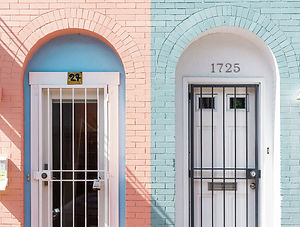 Two colourful brick doorways side by side