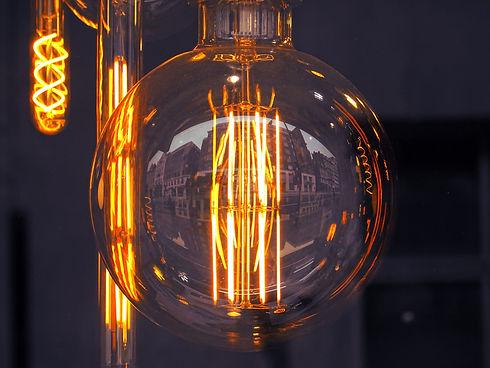 Canva - Lighted Clear Glass Light Bulb.j