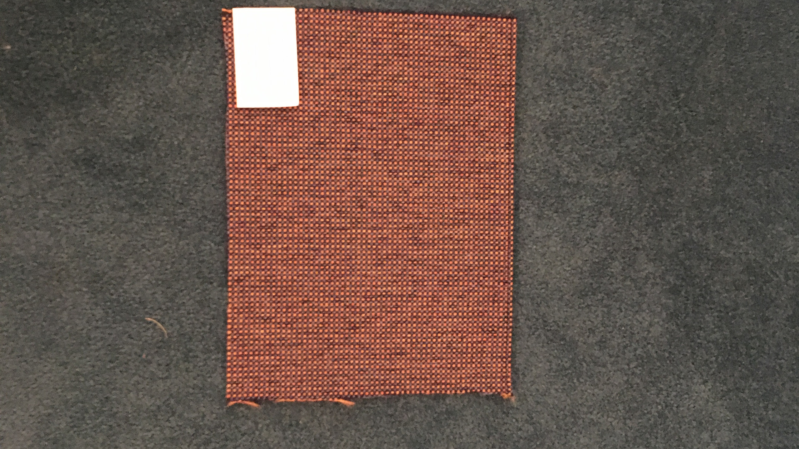Fabric sample on carpet - mid range
