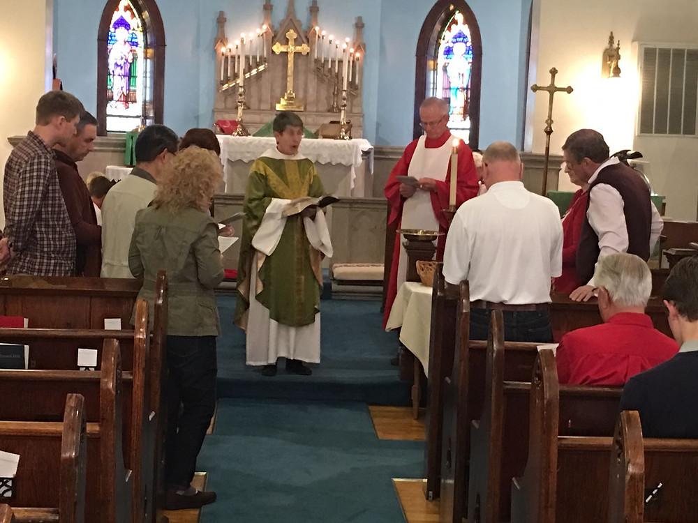 Mother Joan installing the 2017 Vestry members