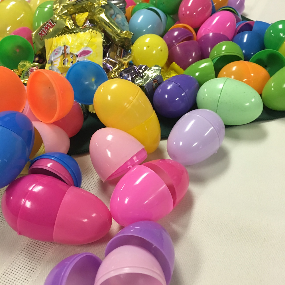 Candy and plastic eggs scattered across a table