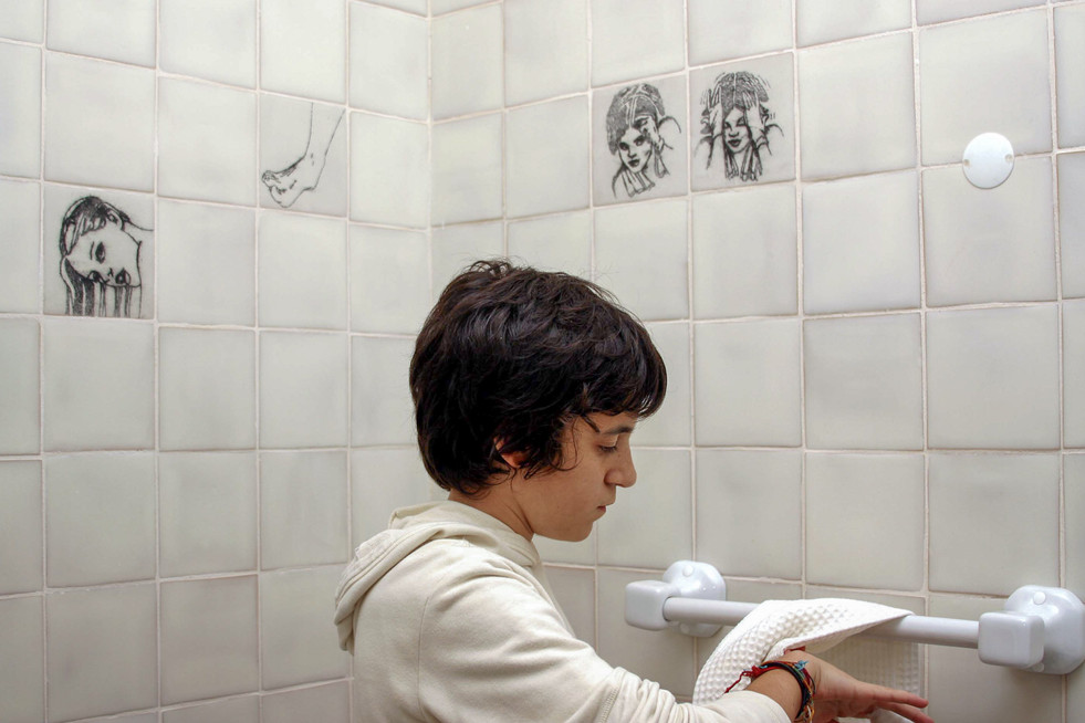 Young Salomé Lamas with Cristina Lamas' mosaics