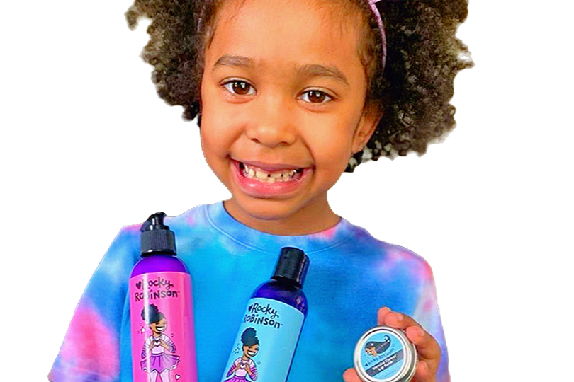 Image of young girl holding two Rocky Robinson self-care products