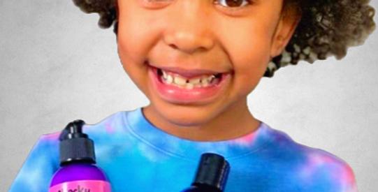 Image of girl holding 1 bottle of body lotion, 1 bottle of shower gel and 1 tin of lip balm