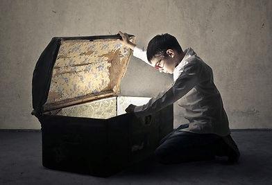 boy finding hidden gold in chest